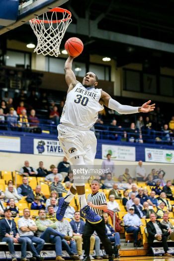 Deon J. Edwin slam dunks during a game for Kent State. Photo: Getty Images