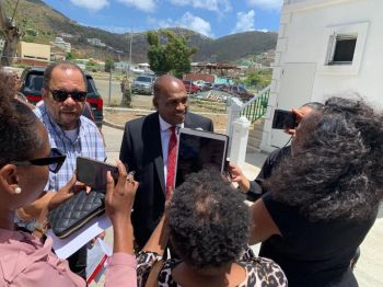 Fourth District Representative-Elect Mr Mark H. Vanterpool, centre, speaks to reporters after the High Court on May 2, 2019 ordered the Speaker Hon Julian Willock to swear him in to the House of Assembly. Photo: Facebook