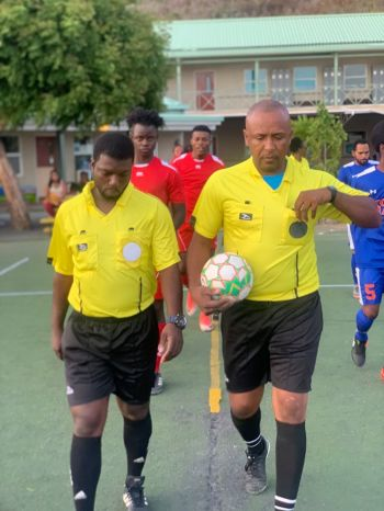 Referees lead the teams out for action in the BVI Football Association (BVIFA) Futsal League at Cedar International School on May 25, 2019. Photo: Facebook