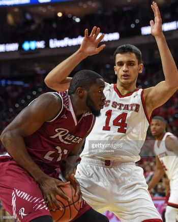 Rider Broncs forward Norville S. Carey (21) goes up for a shot against North Carolina State Wolfpack center Omer Yurtseven (14) during the game between the Rider Broncs and the North Carolina State Wolfpack on December 28, 2016. Photo: Internet Source