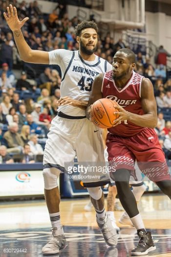 Norville S. Carey (with ball) posted his sixth double-double of the year with 11 points and 10 rebounds on Friday February 3, 2017. Photo: Getty Images/File