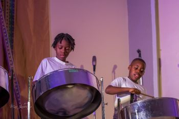 Children learning to play the steel pans at the Sanctuary of Hope Music School. Photo: Facebook/File