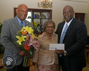 Also visiting Mrs Emogene A. Creque on her 100th birthday on July 22, 2019 were Minister for Health and Social Development Honourable Carvin Malone (AL), right, and Minister for Natural Resources, Labour and Immigration Honourable Vincent O. Wheatley (R9), left. Photo: GIS/Facebook