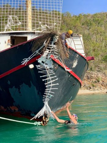 A skeleton mermaid attached to the bow of the Willy T. Photo: Beyond The Reef/Facebook
