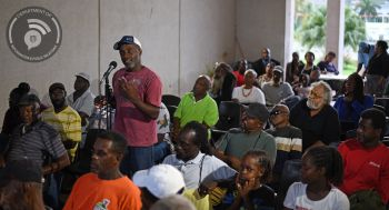A member of the audience gives his feedback. Photo: Franklyn Skerritt/GIS)