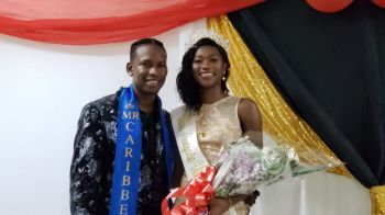 The Miss Anegada Ultimate Teen Queen 2019, Ms Kimberly A. Smith, right, was crowned by Mr Caribbean, Yohance T. Smith, left. Photo: VINO