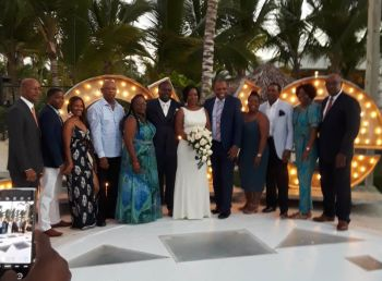 The newly weds flanked by their political guests that included former Premier Dr D. Orlando Smith, left, Second District Representative Hon Melvin M. Turnbull (R2), 2nd from left, Hon Alvera Maduro-Caines (R6), 5th from left, Ronnie W. Skelton, right, Dr Kedrick D. Pickering, 3rd from right, and Hon Mark H. Vanterpool (R4), 5th from right. Photo: Team of Reporters