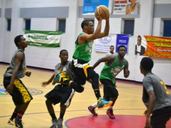 Young Starz and Spartans clashing in the 2014 Hon Julian Fraser National Basketball League. Photo: Charlie E. Jackson/VINO/File