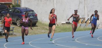 Sprinter Beyonce A. DeFreitas, centre, who was expected to make the finals of the Girls 200 Under 20 event at the Flow Carifta Games in The Bahamas, did not take to the start line of the heats on April 1, 2018. Photo: Photo: Cleave M. Farrington/BVIAA/File