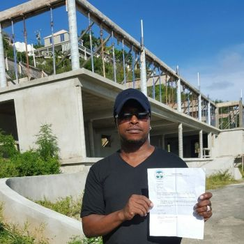 Mr Wilfred M. Smith said his project was scheduled to be completed in September 2015 and the delay is causing him to lose money. Photo: VINO/File