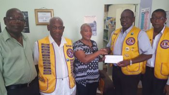 Director of Family Support Network (FSN) Dr Sylvia M. Simmonds (centre) receives a donation from the Lions Club of Tortola back in August 2016. Photo: VINO/File