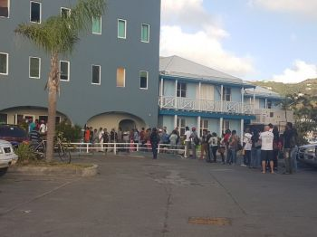Persons outside of the Department of Immigration more than an hour before opening hours during last week. Photo: VINO/File