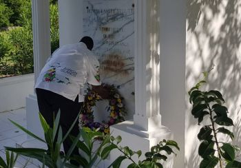 Premier and Minister of Finance, Hon Andrew A. Fahie (R1) lays a wreath at the grave of the Territory's first Chief Minister, Mr H. Lavity Stoutt on March 2, 2020. Photo: VINO