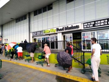 These are difficult times the Governor warned and said it will likely remain difficult for some time to come. Photo of shoppers line up outside RiteWay Food Markets in Pasea Estate on March 26, 2020. Photo: VINO/File