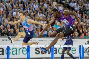 Hurdler Kyron A. McMaster, right, seen here in battle with Karsten Warholm of Norway in a Diamond League meet in Paris on August 24, 2019, has ended the year third in the World Rankings. Photo: IAAF/File