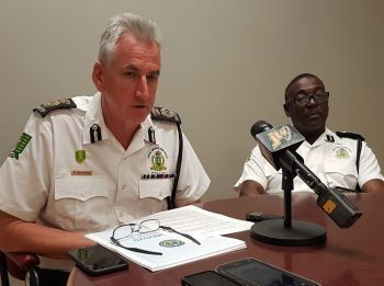 Police Commissioner Michael B. Matthews, left, has asked the public for patience as the Royal Virgin Islands Police Force (RVIPF) experiences an influx of applications for police clearance certificates. Photo: VINO/File
