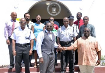 Deputy Financial Secretary, Mr Wendell M. Gaskin handed over the keys of the refurbished police station to the Permanent Secretary in the Deputy Governor's Office, Mr David D. Archer on September 25, 2015. Photo: GIS