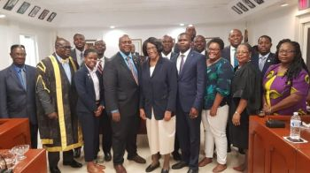 Members of the House of Assembly (HoA) on October 18, 2019 posed for a photograph with the family of Honourable Ralph T. O'Neal OBE following the resolution to rename Central Administration Complex in honour of the political stalwart who dedicated his entire professional life to public service. Photo: Facebook/File