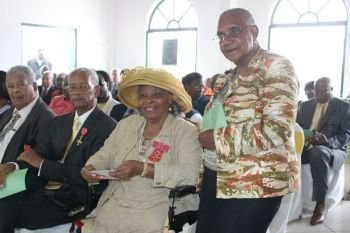 From left: Then Leader of the Opposition Hon Ralph T. O'Neal, OBE; Premier Dr The Hon. D. Orlando Smith, OBE; Mrs Eileene L. Parsons, OBE and Mrs Alda Montsanto. Photo: VINO/File
