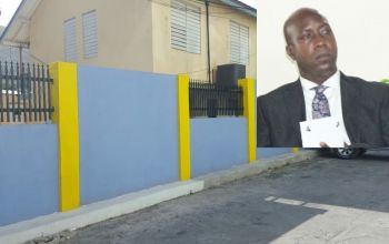 The public and teachers were outraged when Education Minister Hon Myron V. Walwyn (AL) wasted a million dollars to build a small wall around the Elmore Stoutt High School just before the 2015 snap election when schools did not even have toilet paper or water. Photo: VINO/File
