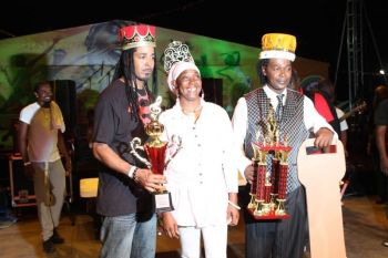 Martino 'Tino' Mark (left) etched his name into the history books as the first ever Virgin Islands Emancipation Festival's Soca Groovy Monarch. Tino emerged victorious when the competition was held at the Ira Oliver Skelton Festiville on Tortola on July 31, 2013. Photo: VINO/File