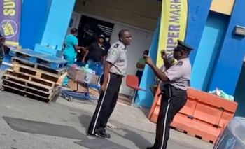 Two officers from the Royal Virgin Islands Police Force (RVIPF)- Traffic Officer Glenn Callwood aka 'Supa Cop,' (right) and Alwyn M. St Hillaire- found themselves in a verbal spat, which almost turned physical over what was alleged bad parking by the entrance of the OneMart Supermarket in Purcell Estate on Wednesday, April 22, 2020. Photo: Team of Reporters