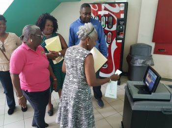 While National Democratic Party (NDP 1) Chairman, Hon Myron V. Walwyn (AL) have urged citizens that the voting machines were just counting machines, many voters throughout the territory especially the young and the elderly have claimed that they do not trust the machines. Photo: File/GIS