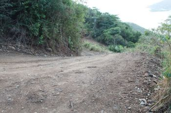 The steep turn at Sabbath Hill where two errant vehicles were allegedly parked on and partly blocking the road, which made it challenging for any vehicle on the ascend to effectively negotiate the deep bend. Hon. Alvera Maduro-Caines is calling for urgent priority to be given to the road. Photo: VINO