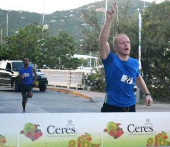 James Carr seen here holding off the spirited challenge of Ravindra Sukhu to win the Ceres Juices 10K finale on Saturday November 3, 2012. Photo: File