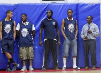 Some of the Knights players at the opening of the Hon Julian Fraser Save the Seed Basketball League at the Save the Seed Energy Centre on August 15, 2015. Mr Verne W. Turnbull is at right. Photo: VINO/File