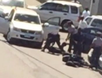 A still clip from the video where a motor scooter rider was thrown to the ground in the vicinity of Moneygram on Fishlock Road on February 17, 2017. Photo: Provided