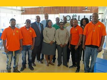 The four linesmen (in orange tops) from the BVI Electricity Corporation (BVIEC) were on October 7, 2019, deployed to help the hurricane-ravaged Bahamas Islands of Grand Bahama and Abaco in their electricity restoration efforts. Photo: Facebook/File