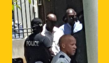 As a result of Operation Lucan, three officers (2 in background) of the Royal Virgin Islands Police Force (RVIPF) appeared on April 5, 2016 in the Magistrate's Court charged with various offences. Photo: VINO/File