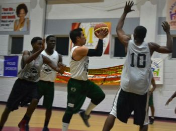 Bayside Blazers' Louis E. Poblete going hard to the basket against Desert Storm during the 2014 Hon Julian Fraser Save the Seed Basketball League. Photo: Charlie E. Jackson/VINO