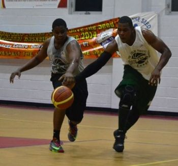 Sandy E. Nadal (right) of the Bayside Blazers tussles with a Desert Storm player for possession of the ball during the 2014 Hon Julian Fraser Save the Seed Basketball League. Photo: Charlie E. Jackson/VINO