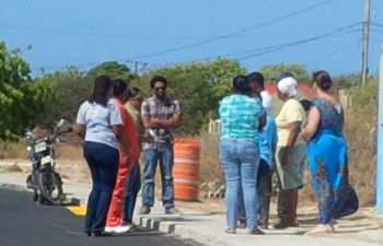 Parents as they gathered outside of the Claudia Creque Educational Centre in Anegada on May 4, 2015. Photo: VINO/File