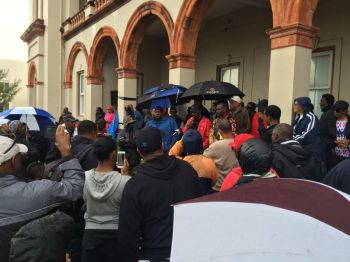 The Overseas Territory of Bermuda's House of Assembly was shut down on Monday 14, March 2016 after legislators were locked out by protesters, including members of the Opposition Progressive Labour Party (PLP), who formed a cordon around the building in a continuing protest against the government's proposed immigration legislation. Photo: Thomas Christopher Famous