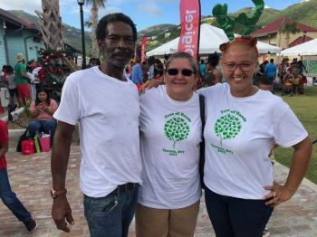 Alexandra V. Durante, right, with her parents Carol Durante, centre, (one of the founders of Tree of Hands) and Lutia Durante at Tortola Pier Park on December 16, 2017. Photo: Digicel