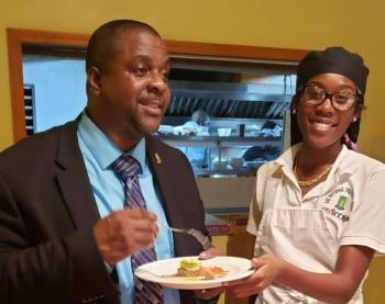 Premier and Minister of Finance Honourable Andrew A. Fahie (R1), left, savouring a sample provided by the National Culinary Team. Photo: Team of Reporters