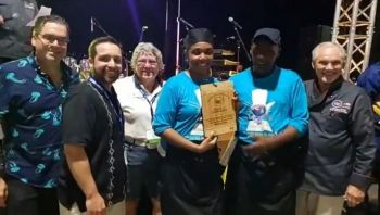 Virgin Islands' Senior Chef Caswall Ponte, 5th from left, and Chef Jolece Fraser, 4th from left, took third place in the Contemporary Caribbean Individual Street Pork Competition held in Miami, Florida on June 22, 2019. Photo: Team of Reporters