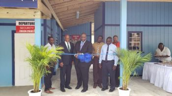 Premier and Minister of Finance Honourable Andrew A. Fahie (R1) cuts the ribbon to symbolise the reopening of the West End Port on August 2, 2019. The facilioty had remained closed since the passage of Hurricane Irma in September 2017. Photo: VINO/File