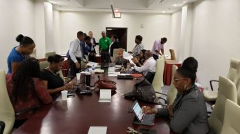Rotary volunteers take account of the pledges made at the Rotary telethon for Bahamas relief at Maria's by the Sea on September 11, 2019. Photo: VINO