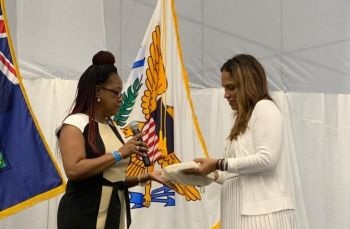 Virgin Islands' First lady Mrs Sheila E. Forbes-Fahie, left, presented a gift to USVI's First Lady Mrs Yolandan Bryan, right. Photo: Team of Reporters