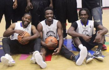 Ray D. Victor, seen here with Nicols Charles, left, and Rowan Victor, right, of Pure Playaz after winning the 2019 Hon Julian Fraser Save the Seed National Basketball League in November 2019, said he had wanted underdogs Miami Heat to win the 2020 NBA Finals. Photo: VINO/File