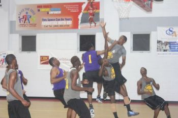 Action from the 2014 Honourable Julian Fraser Save the Seed National Basketball League. Photo: VINO/File