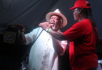 The legendary Jost Van Dyke resident and owner of Foxy's, Philicianno 'Foxy' Callwood, OBE (left). Photo: VINO/File
