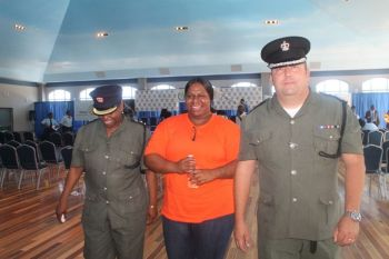 Ms Thomas (centre) with Superintendent of Prisons Mr David Foot (right) and another prison officer at the FTM's seminar in 2014. Photo: VINO/File