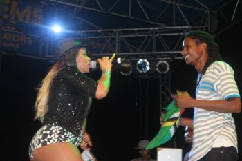 Lucky guy! Destra Garcia (left) during the Carrot Bay Festival stage show on Friday August 9, 2013. Photo: VINO/File