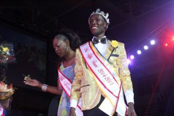 Akeem Stanley with Pageant Coordinator Mrs Bisa Smith after being crowned Mr Fifth Form back in April 2015. Photo: VINO/File