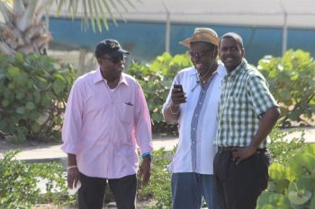 Virgin Islands Party (VIP) Chairman Hon Julian Fraser RA (R3), seen here with VIP President Carvin Malone, and Hon Andrew A. Fahie (R1) at the Virgin Gorda Easter Parade on April 6, 2015 had said that the issue of a timely start to the parade needed to be addressed. Photo: VINO
